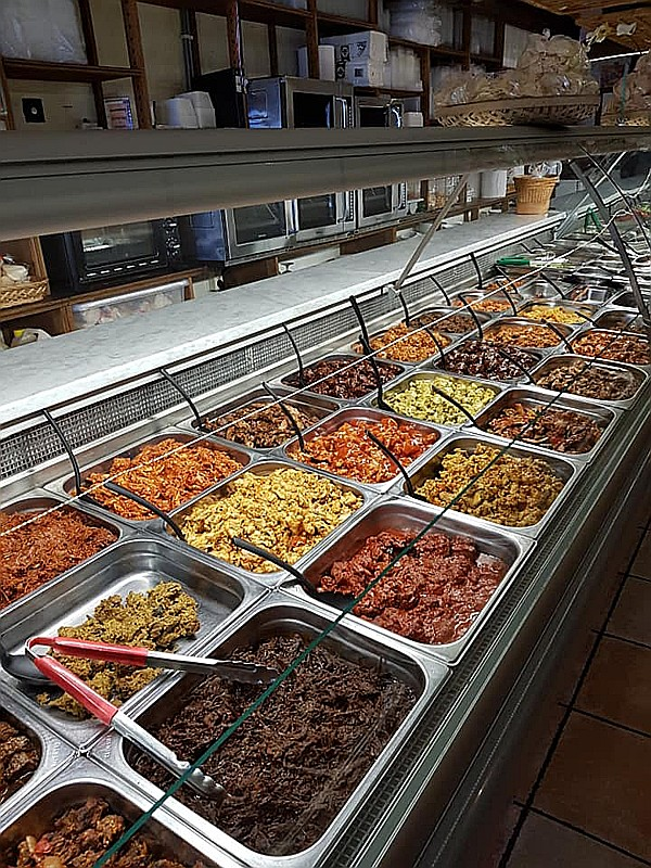 Display case with over 70 Halal dishes at Indonesian Restaurant Anak Blitar in Hoofddorp